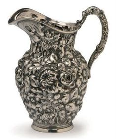Silver Repousse Water Pitcher $3,000