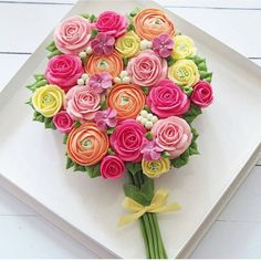 Great Idea! Cupcakes decorated to look like a bouquet of flowers!