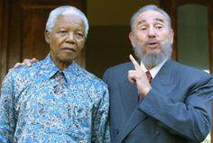Cuban president Fidel Castro (R) express