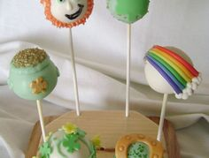 assortment of St Patrick's Day cake pops, leprechauns - shamrocks - rainbows - horseshoes - pots of gold, vanilla cake/vanilla ABC/white bark, MMF and piped candy adornments, pearl-dust and sprinkle accents