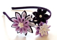 The flowers are made in the technique of tsumami kanzashi.  Metallic headband is weaved with satin ribbon.  Flowers are made from grosgrain ribbons. At