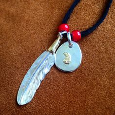 Larry Smith Eagle Head Feather + Eagle Head Medallion. (silver, gold, beads, craftsmanship, made in japan, hand made)