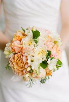 Brides.com: 15 Pretty Peach Bouquets. Bouquet of peach-and-white garden roses from Beehive Events.