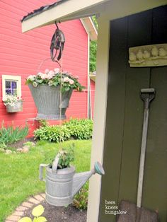 use an old pulley as a plant hanger and mount an old garden tool on the shed wall