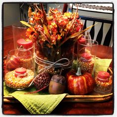 Fall decor - Love this idea for the table. I'll par it down to two wine glasses and a centerpiece with pumpkins and gourds.