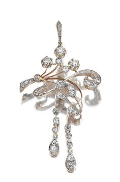 DIAMOND BROOCH/PENDANT, EARLY 20TH CENTURY.  Designed as a stylised tied bouquet with articulated cascades of ribbons, set throughout with circular-cut diamonds, maker's marks, Russian assay marks.