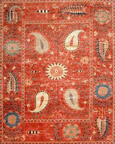 Suzani with Uzbek silk rug