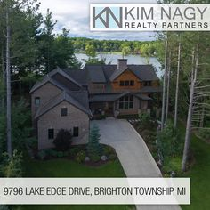 "Just Listed | 9796 Lake Edge Drive  Beautiful rustic reclaimed 100+ y/p barn timber frame meet's luxury finishes and thoughtful environmental efficiency in this stunning custom-built dream home on tranquil Lyons Lake. Natural wide-plank Oak flooring t/o and Windsor Pinnacle wd casement windows framing your views. Great Room boasts Cathedral ceilings, floor to ceiling windows and stone fireplace opening to kitchen w/ double convection oven, 36"" cooktop, dual dishwashers, custo"