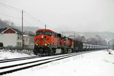 BNSF freight train K-057 in the snow with ES44 #5836 in the lead