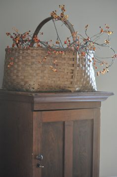antique basket. bittersweet.do this above the entertainment cabinet