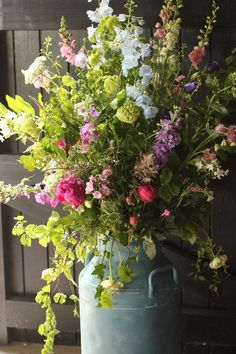Try arranging your flowers in a vintage milk churn for a rustic, informal look.