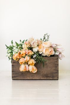 Floral arranging in a wood box container
