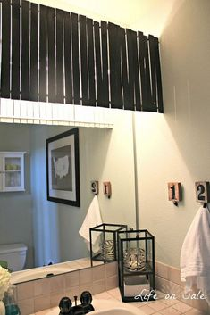 DIY Bathroom Makeover :: Hometalk Interesting way to cover hollywood light fixture