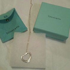 Tiffany & Co,  Silver Heart Necklace /Brand New Its brand new Never worn. Very beautiful necklace,   Elegant chain, and its silver in color Its Authentic, and all girls love Tiffany Make offers if you want Tiffany & Co. Jewelry Necklaces