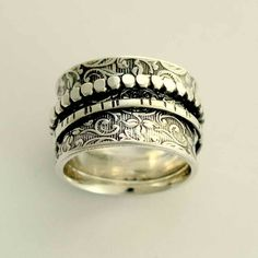 Sterling silver spinners on a filigree wide band - A way of life 2.. $122.00, via Etsy.