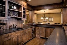 Love the color of Stain Wood Kitchen cabinets knotty alder wood - different back. - Love the color of Stain Wood Kitchen cabinets knotty alder wood – different backsplash though - Rustic Kitchen Cabinets, Rustic Kitchen Design, Kitchen Decor, Kitchen Designs, Kitchen Wood, Basement Kitchen, Dark Cabinets, Rustic Basement, Modern Basement