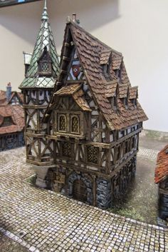 Cast of resin by Tabletop World Listed as a mansion. Lovely paint job.