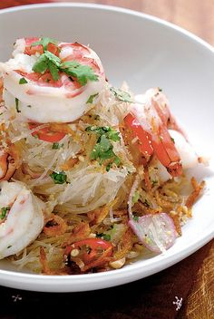 Thai Noodle Salad ~ 150 gr dried glass/mung bean noodles,  16 med to large prawns- shelled & cleaned,1/2 cup of spring onions, roughly chopped, 1/3 cup coriander leaves roughly chopped, 1 red onion sliced thinly, 2 cloves garlic minced finely, 5 tbsp dried shrimps or sakura ebi, 3 red chillies, seeds removed & sliced finely, 3-4 tbs chopped roasted peanuts or cashew nuts, 4 tbsp fish sauce, 2 tbsp brown sugar, 8 tbsp lime juice #kerabu