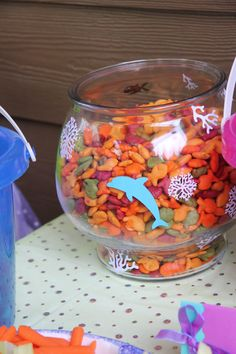 Goldfish crackers were servered in a decorated fish bowl (The birthday girl wants to buy fish with her birthday money....)