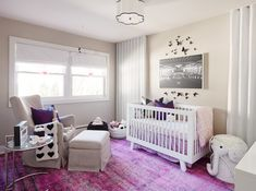 Luxurious purple and gray nursery is furnished with a Babyletto Hudson Crib dressed in purple and white bedding and a purple crib skirt positioned beneath a black and white photo print flanked by black butterfly art mounted on a light gray wall. Girl Nursery, Girl Room, Nursery Room, Nursery Themes, Room Themes, Nursery Decor, Nursery Ideas, Baby Decor, Children