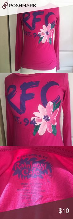 Rainforest Cafe L sparkle flower long sleeved top Rainforest Cafe size L but fits like a medium 100% cotton very thin fabric long sleeved shirt Has a huge gorgeous flower in the front that has glitter - tags off but never worn Smoke free home Rainforest Cafe Tops Tees - Long Sleeve
