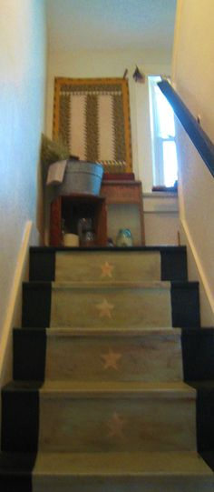 My poor old stairwell that I have painted yet again. Would love to have some braided treads. I am still in the process of making little quilts for the walls. The one at the top is Bible themed quilt and I quilted a sacred heart pattern on it.