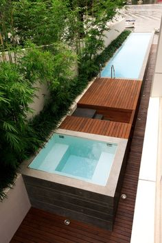 great use of space in this side yard. lap pool and spa, bamboo. Steps in the center lead from the ground deck to the upper deck of the pool.
