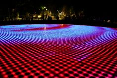 Croatian architect Nikola Bašić's LED light installation titled Saudação ao Sol, translated as Greeting to the Sun, is a remarkable piece of public art that efficiently incorporates technology. The circular floor installation consists of three hundred multilayered glass plates encasing solar cells that absorb sunlight during the day and come alive at night, putting on a spectacular light show. The animated light piece adds another layer of beauty to the scenic coastal town of Zadar, Croatia.