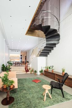 A Steel Staircase Merges Two Units Into One in Tribeca - Photo 9 of 13 - The stairs partially suspend from the ceiling above, allowing the living space to maintain its usable space and height.
