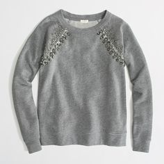Cute jeweled sweatshirt. Sweatshirts like this are really in right now and stylish. I love ones with jewels or studs or patterns on it. They look really cute with jeans, leggings and yoga pants with sneakers or Uggs. They are good to wear to school, to relax on the weekends or to a friends house to hangout.