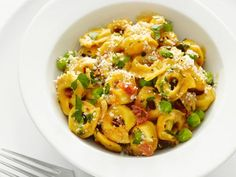 Get this all-star, easy-to-follow Tortellini with Peas and Prosciutto recipe from Food Network Kitchen