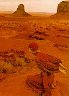 Taken by English photographer Norman Parkinson at Monument Valley, Arizona for Vogue UK, 1971.