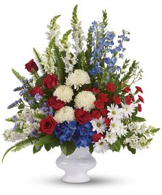 A dazzling display of patriotic red, white and blue flowers sends a silent yet poignant statement about hope, freedom and the strength to endure. This proud bouquet is a testament to life that is sure to be appreciated.  Teleflora SKUs: ,T240-1A,T240-1B,T240-1C