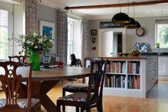 Dining Area with Bookcase Counter inside architect Ptolemy Dean's Sussex newbuild farmhouse. Discover dining area design inspiration from real homes on House & Garden.