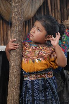 This is young lady in San Antonio Aguas Calientes, Guatemala. The opportunity to meet her family, watch her grandmother weaving on a backstrap loom and photograph her home was a gift. Her village is a short ride from Antigua and is know for it's beautiful textiles. I love the way this photo captures her hand - it is such a three-year-old kind of gesture.