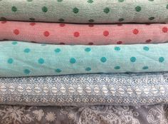 My actual stash! Pollora Spring dots, Passion Polka, Polka turquoise, Didymos Indio Seabreeze, Fidella Iced Butterfly Smoke
