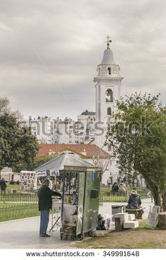 BUENOS AIRES, ARGENTINA , AUGUST - 2015 - Lots of people in park with the white basilica behind in recoleta park in Buenos Aires, Argentina.