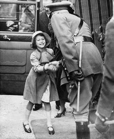 1936 Princess Elizabeth greets an officer.