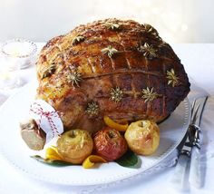 Sticky maple-glazed ham with baked apple sauce. Slow-roast a whole leg of gammon with apple juice, then cover in a sticky spiced glaze for a Christmas treat - perfect sliced hot or cold Bbc Good Food Recipes, Cooking Recipes, Dinner Recipes, Christmas Lunch, Christmas Roast, Christmas Cooking, Family Christmas, Christmas Recipes, Maple Glazed Ham