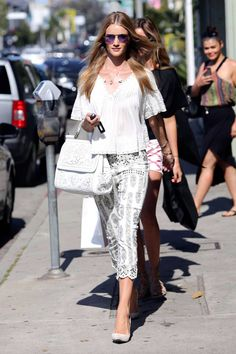 Whether they're stepping off a yacht, or taking their pup for a walk in the city, take notes from these top models' enviable summer wardrobes.