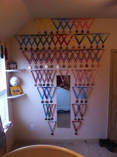 Medal wall from all of my gymnastics medals my dad created for me!