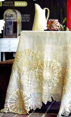 Bring new life to a table cloth by adding grandma's doilies at the bottom.