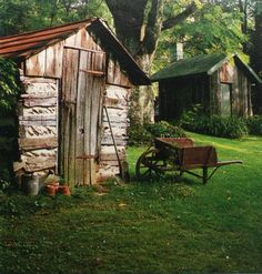 .love this farmhouse scene..old shed....hand made wheelbarrow and little cottage.....