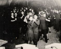 Servicemen dancing in a hut. WW2.