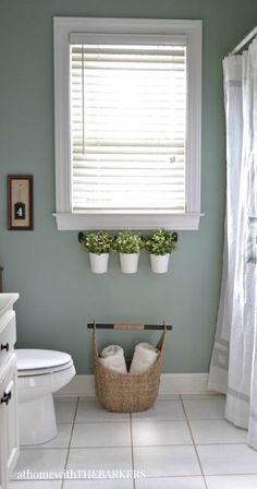 In this bathroom renovation project, Sonya of @withthebarkers completely transforms an outdated bathroom to a relaxing and modern space with a fresh coat of Green Trellis. She replaces old decor with earthy plants along the window sill and a soft white shower curtain.