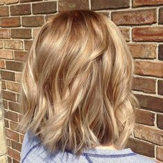 Warm blond balayage on shattered bob hair cut