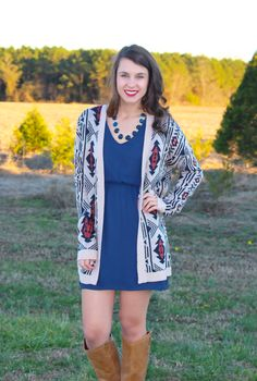 Navy dress with tan cardigan. Truly Yours Boutique