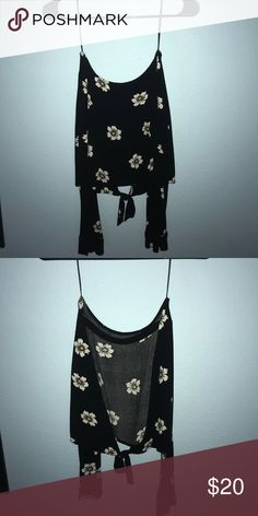 Kylie Jenner open back long sleeve crop top Kylie Jenner open back crop top. I originally bought the wrong size and was to late to return it. Super cute black with flowers open back makes it airy and cool enough for summer Tops