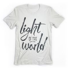 "This is a unisex tee with our ""Light of the World"" design. Fit: Unisex and runs true to size. *Silver with vintage charcoal design. Size Bust/Chest Inches XS 30-32 Small 34-36 Medium 38-40 Large 42-44"
