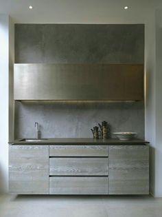 Cozinha minimalista com acabamento em concreto